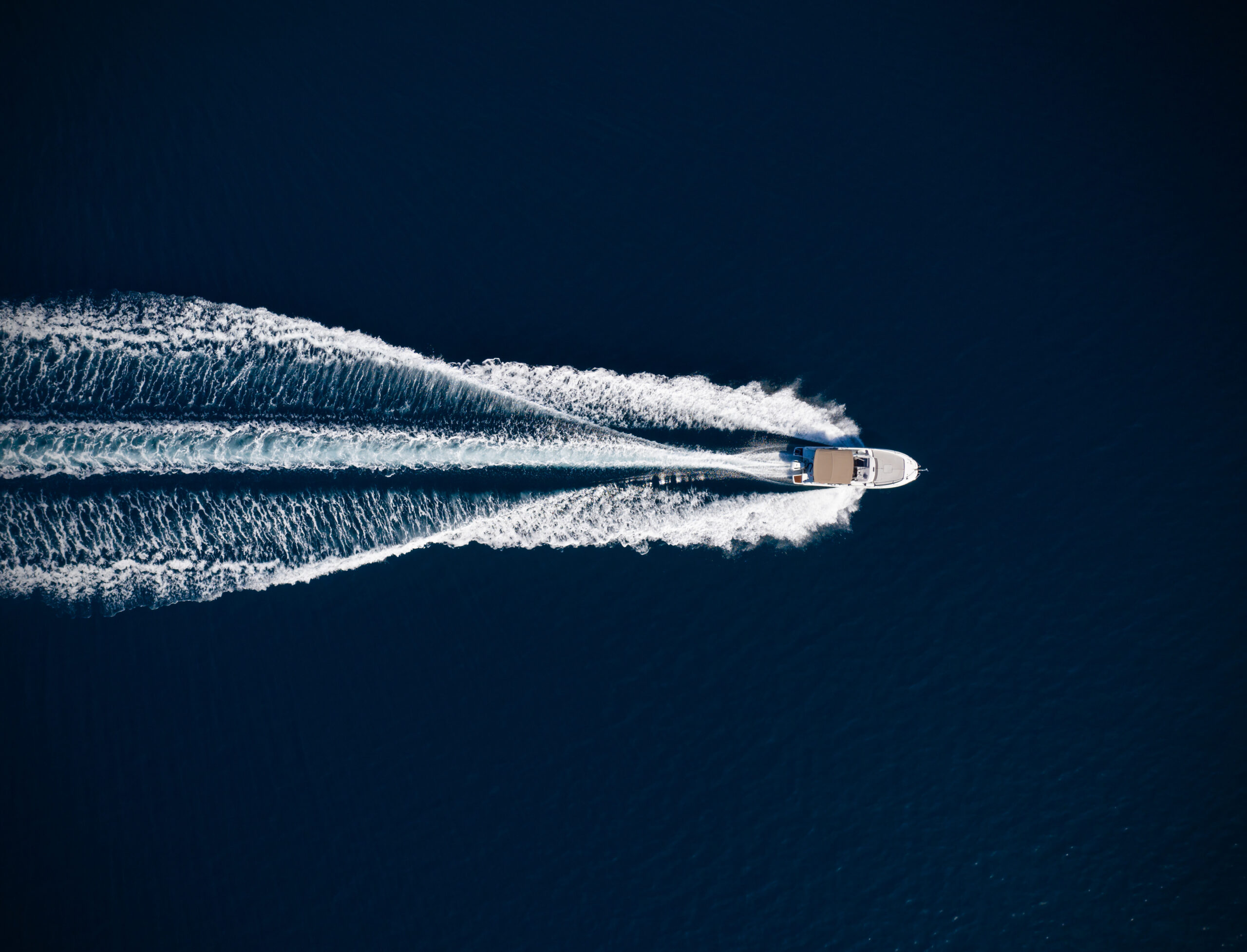 Aerial view of speed motor boat on open sea.