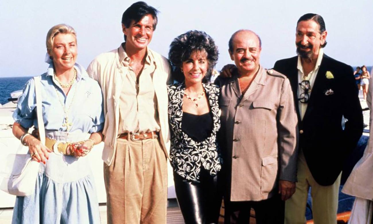 Puerto Banús Margit Ohlson, George Hamilton. Elizabeth Taylor. Adnan Khashoggi and Don Jamie de Mora y Aragon in Puerto Banús in 1986