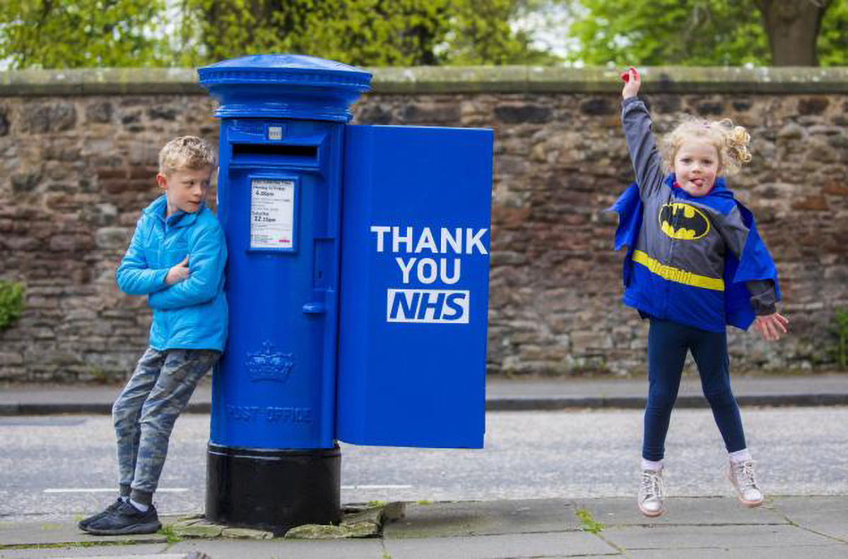 Photo from the Royal Mail of a postbox decorated in tribute to the NHS