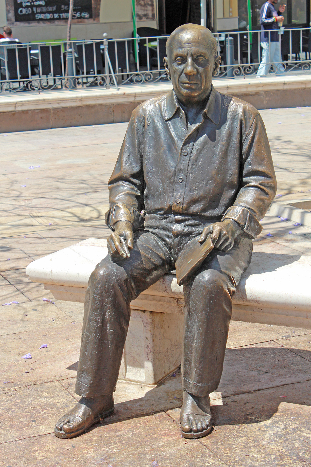 Life-size bronze statue of Pablo Picasso in Plaza de la Merced, adjacent to his family home