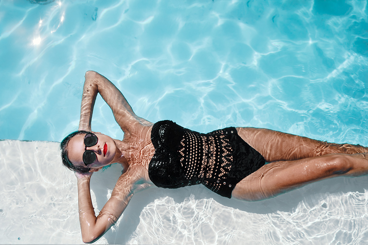 Lady in black costume at Swimming pool