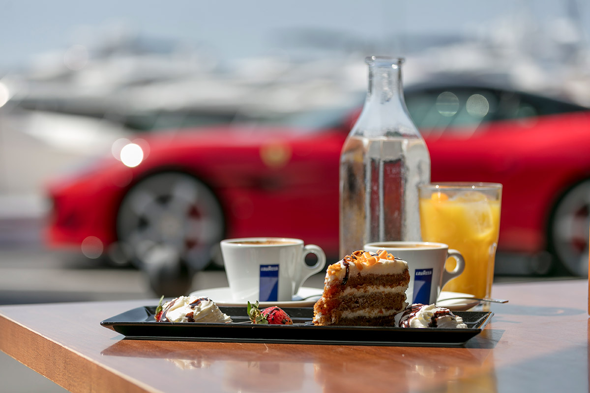 Grab a coffee, sit back and enjoy the people/car show!