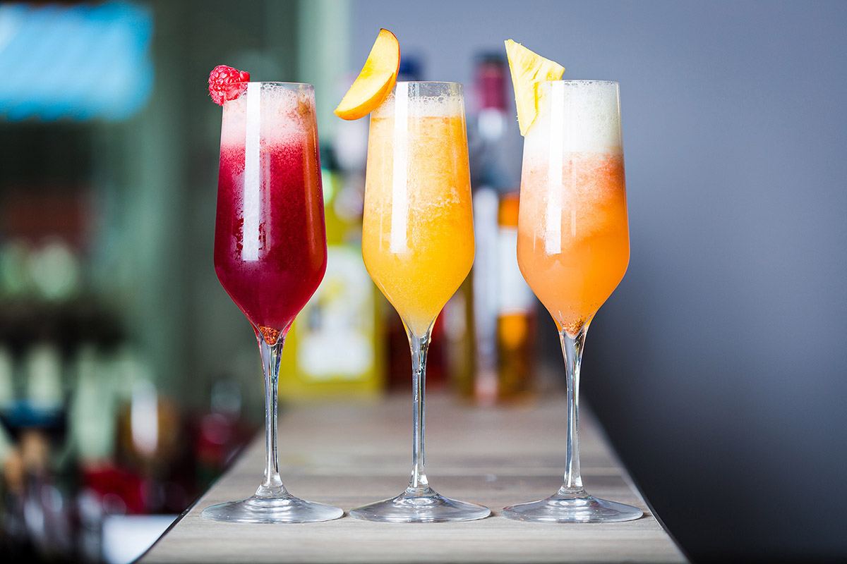 Three colourful champagne Cocktails
