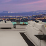 Night view from Vista Lago Residences over Marbella