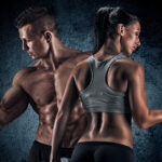 Boy and girl lifting weights