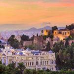 Malaga city skyline at sunset