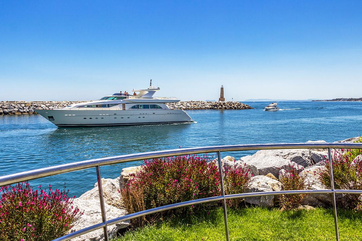 Luxury motorboat arriving at Puerto Banus marina
